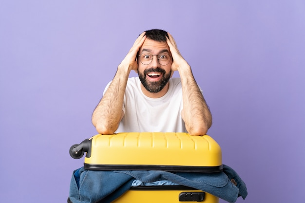 Man doing suitcase over isolated wall