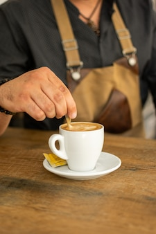 Man doing and taking coffee from espresso machine. profession, lifestyle concept.