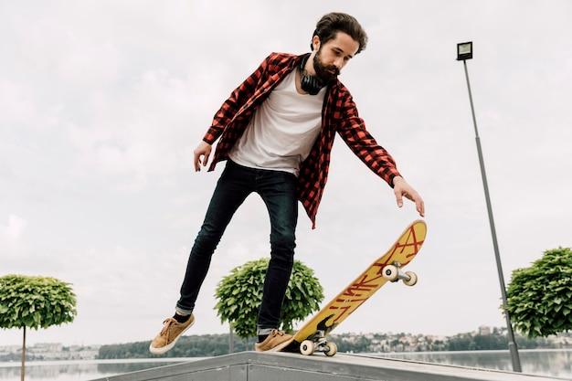 Man doing tricks at skate park
