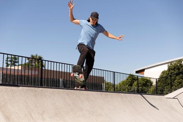 Man doing tricks on skateboard full shot