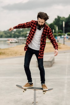 Man doing tricks with the skateboard