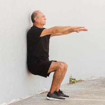 Man doing wall stand fitness exercise