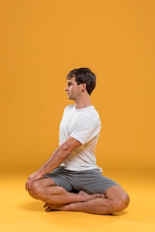 Man doing yoga exercise