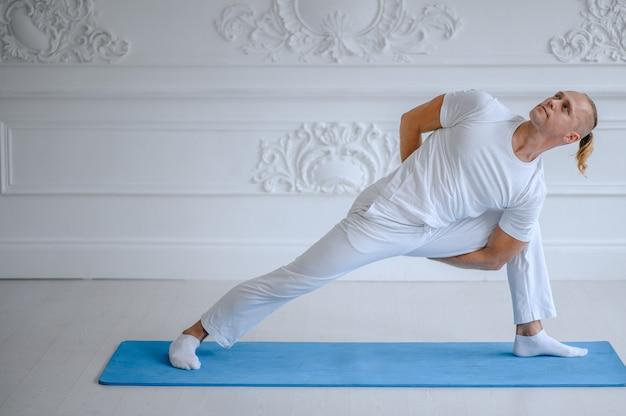 Man doing yoga at home