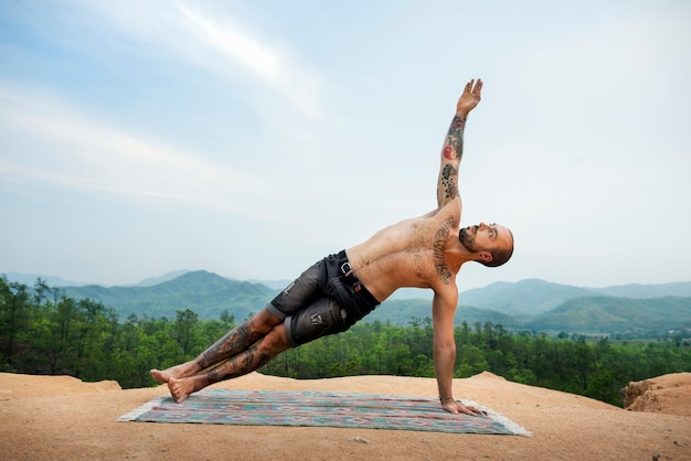 Man doing yoga in the nature