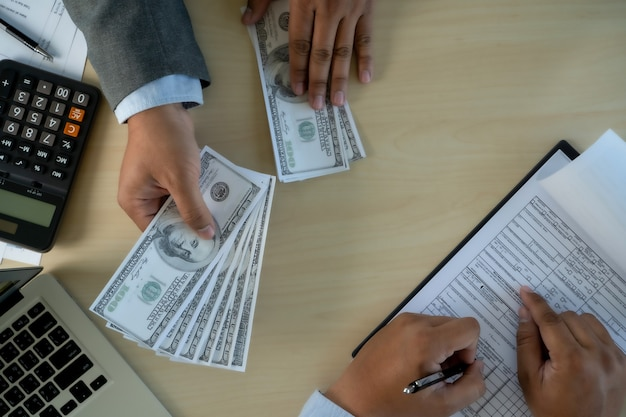 Man dollars money corruption analysing growth profit financial trade funds and currency exchange united states dollars corruption concept Premium Photo
