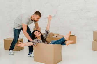 Man dragging woman in box