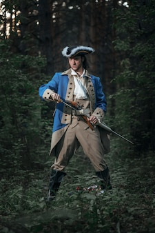 Man dressed as soldier of american revolution war of united states with pistol
