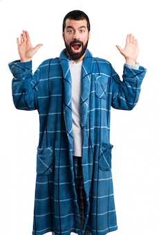 Man in dressing gown doing surprise gesture