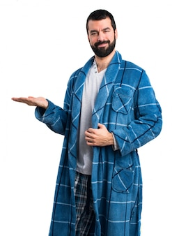 Man in dressing gown holding something