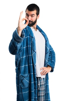 Man in dressing gown making ok sign
