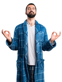 Man in dressing gown in zen position