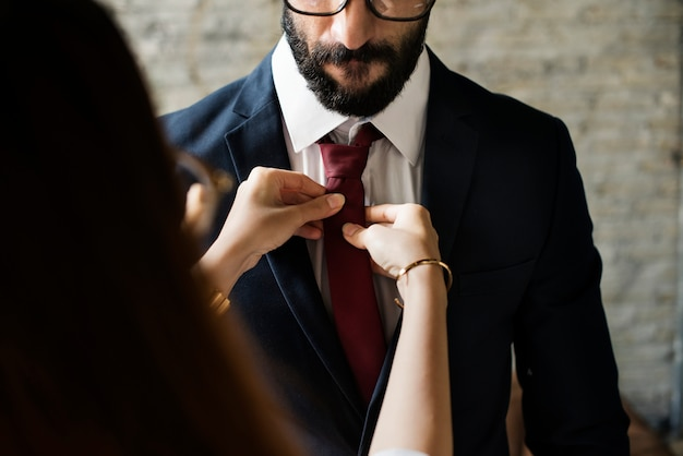A man dressing up with a girlfriend's help