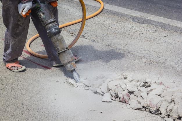 A man drilling road