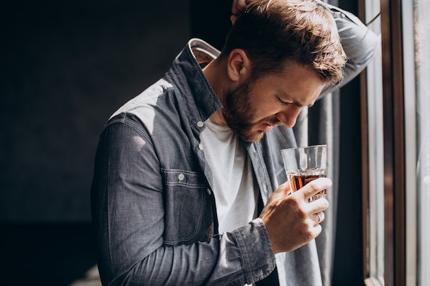 Man drinker depressed with bottle of whiskey