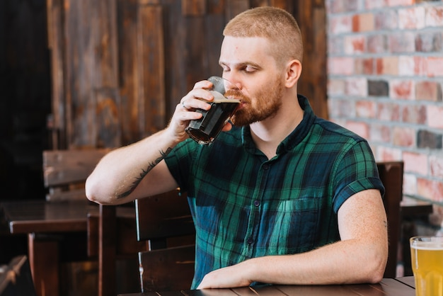 Man drinking alcoholic drink in bar