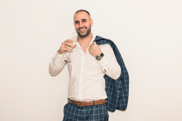 Man drinking champagne from glass