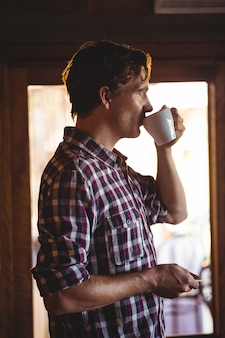 Man drinking coffee alone