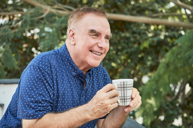 Man drinking coffee outdoors