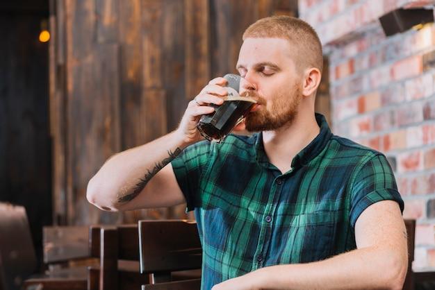 Man drinking rum in bar