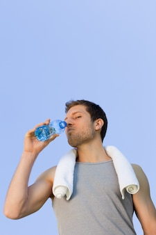 Man drinking water after the gym