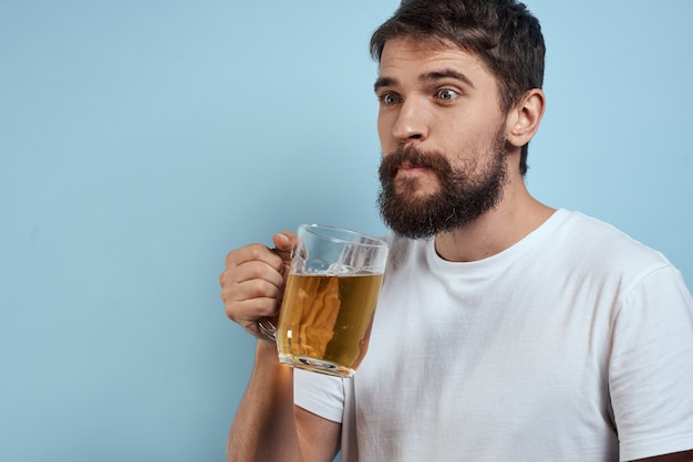 A man drinks beer from a glass