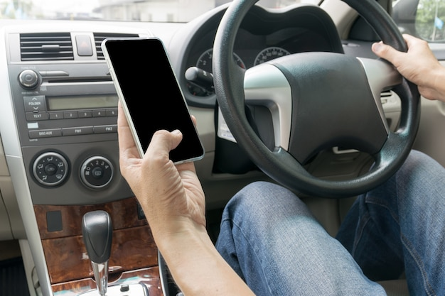 Man driving car and using mobile phone