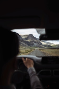Man driving on a dirt road in iceland