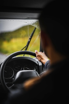 Man driving on a rainy day