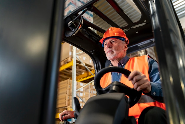 Man driving warehouse loading machine