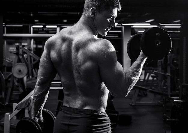Man during his workout in gym