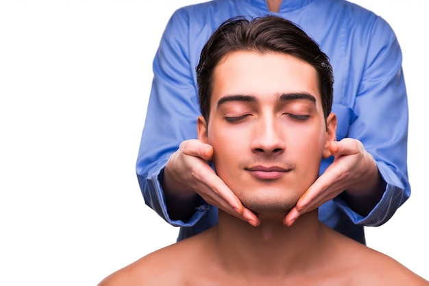 Man during massage session isolated on white