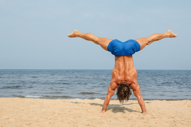 Man during workout on the beach
