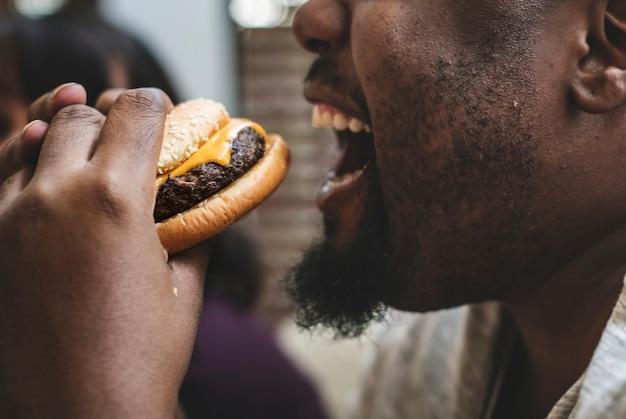 Man eating a big hamburger