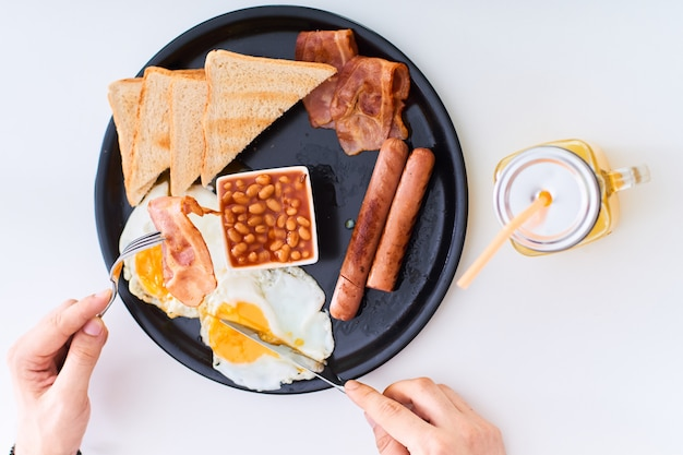 Man eating traditional full english breakfast