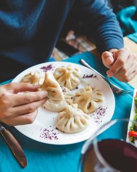 Man eats khinkali