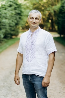 Man in embroidered linen ethnic shirt at nature