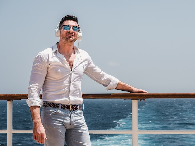 Man on the empty deck of a cruise liner