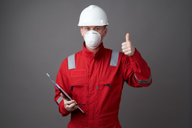 Man engineer, construction worker wearing face mask