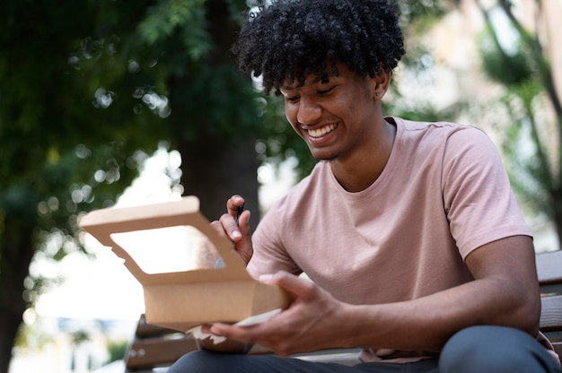 Man enjoying some takeaway food outdoors