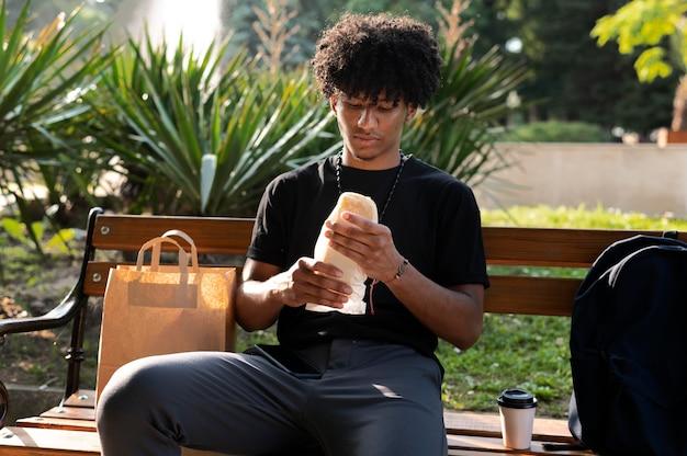 Man enjoying some takeaway food