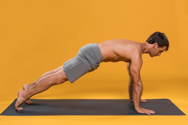 Man exercising on yoga mat