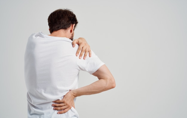 Man experiencing pain in the cervical vertebrae osteochondrosis medicine