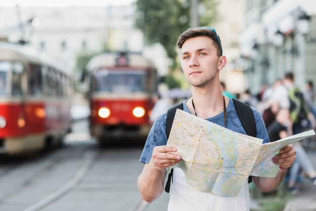 Man exploring city with map