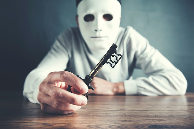 Man face mask with hand key