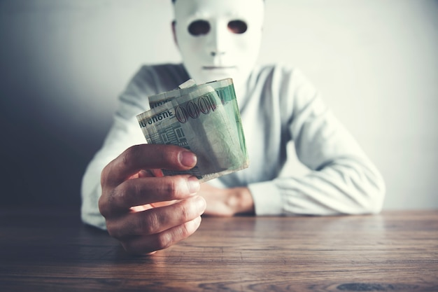 Man face mask with hand money