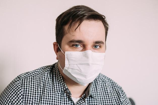 Man in facial hygienic mask