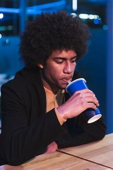 Man in fast food restaurant at night