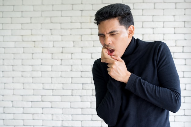 Man feeling hurt from toothache symptom