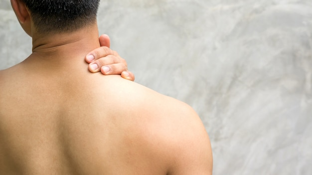 Man feeling pain neck and shoulder.